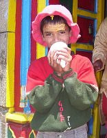 Garhwali Brahmin boy blowing the conch shell outside Madmaheshwar temple, Garhwal Himalaya