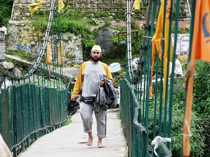 Pilgrim returning from Hemkund, crosses the bridge at Govindghat