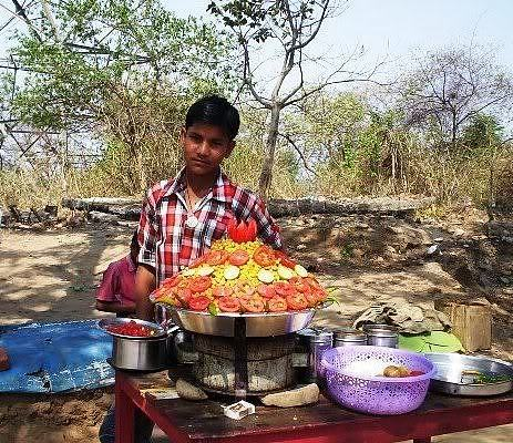 Vendor selling matar alu chaat on the second trek route to Chandi Devi