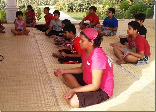 children meditating at vrindavan farm, organic india, lucknow